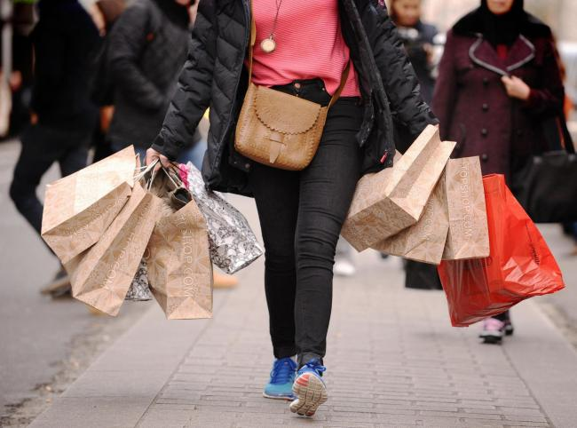 EMBARGOED TO 0001 FRIDAY SEPTEMBER 06..File photo dated 06/12/11 of a person with shopping bags. Soaring temperatures and Brexit uncertainty led to a dire month for the high street in August, figures show. PA Photo. Issue date: Friday September 6, 2019. S