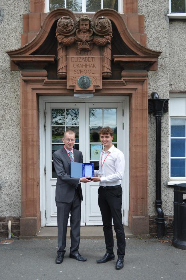Philip Pridmore, of Lamont Pridmore, presents Jack Millward with The Lamont Pridmore Business Studies Student of the Year 2018