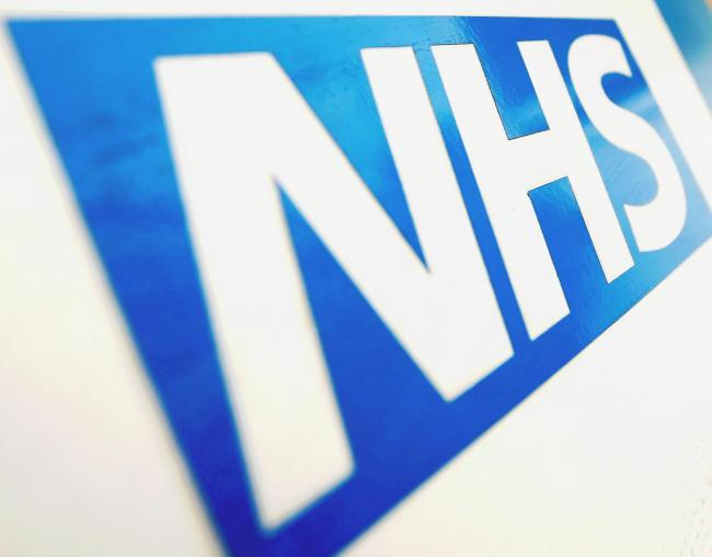 Embargoed to 0001 Saturday June 16..File photo dated 07/12/10 of the NHS logo. Two thirds (66%) of voters - including 63% of Conservatives - would be willing to pay 1p more on their income tax to provide a funding boost for the NHS, according to a new pol