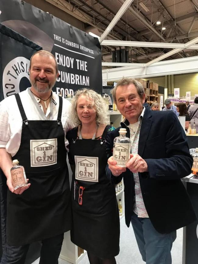 Andy and Zoe Arnold-Bennett of Shed 1 Gin with Nigel Barden at the Farm Shop and Deli Show at Birmingham's NEC 2019
