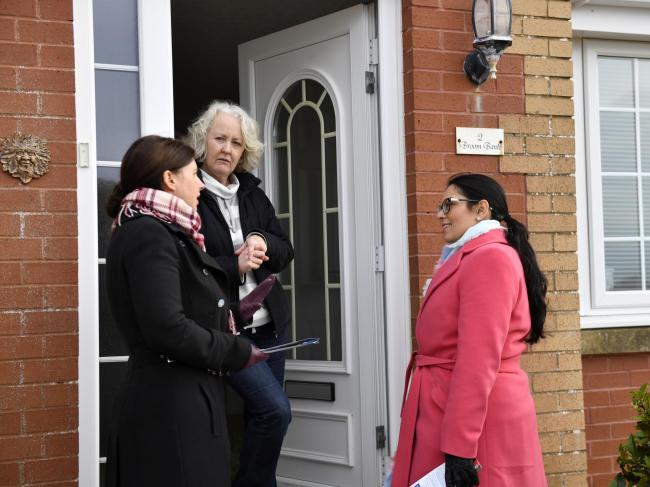 Priti Patel and Trudy Harrison speak to Julie Pennington while canvassing in Whitehaven