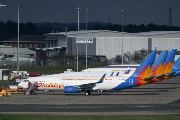 In Cumbria: AIRLINE: Several Jet2 planes have been parked up at Birmingham Airport during the pandemic. Picture: Steve Parsons/PA