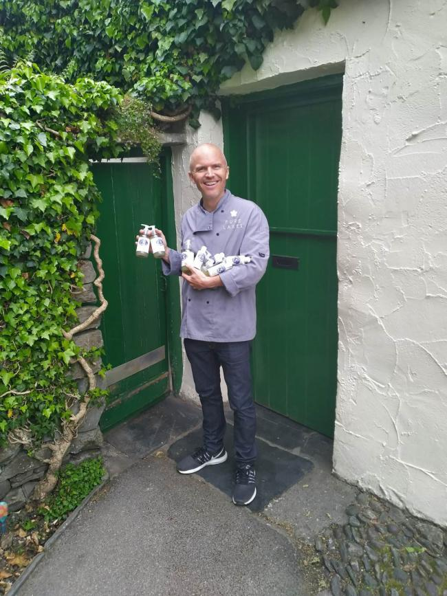APPEAL: Gareth McKeever of Pure Lakes outside a closed Grasmere Gingerbread
