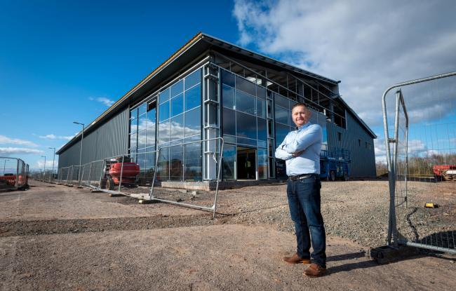 Eddie Black, who runs Eco Group outside the company's headquarters in Annan