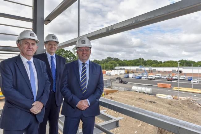 David Atkinson, managing director of Thomas Armstrong Construction, Brian Richardson, chief executive of H&H Group and Scott Harrington, director of Hyde Harrington, at the Rosehill Estate