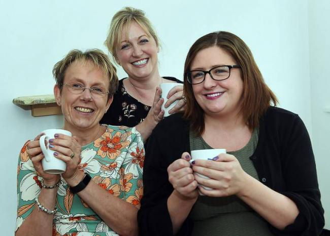 Ann-Marie Steel, left, at Maryport's Hug a Mug service with GP Dr Pauline Gage and surgery practice manager Liz Greggains