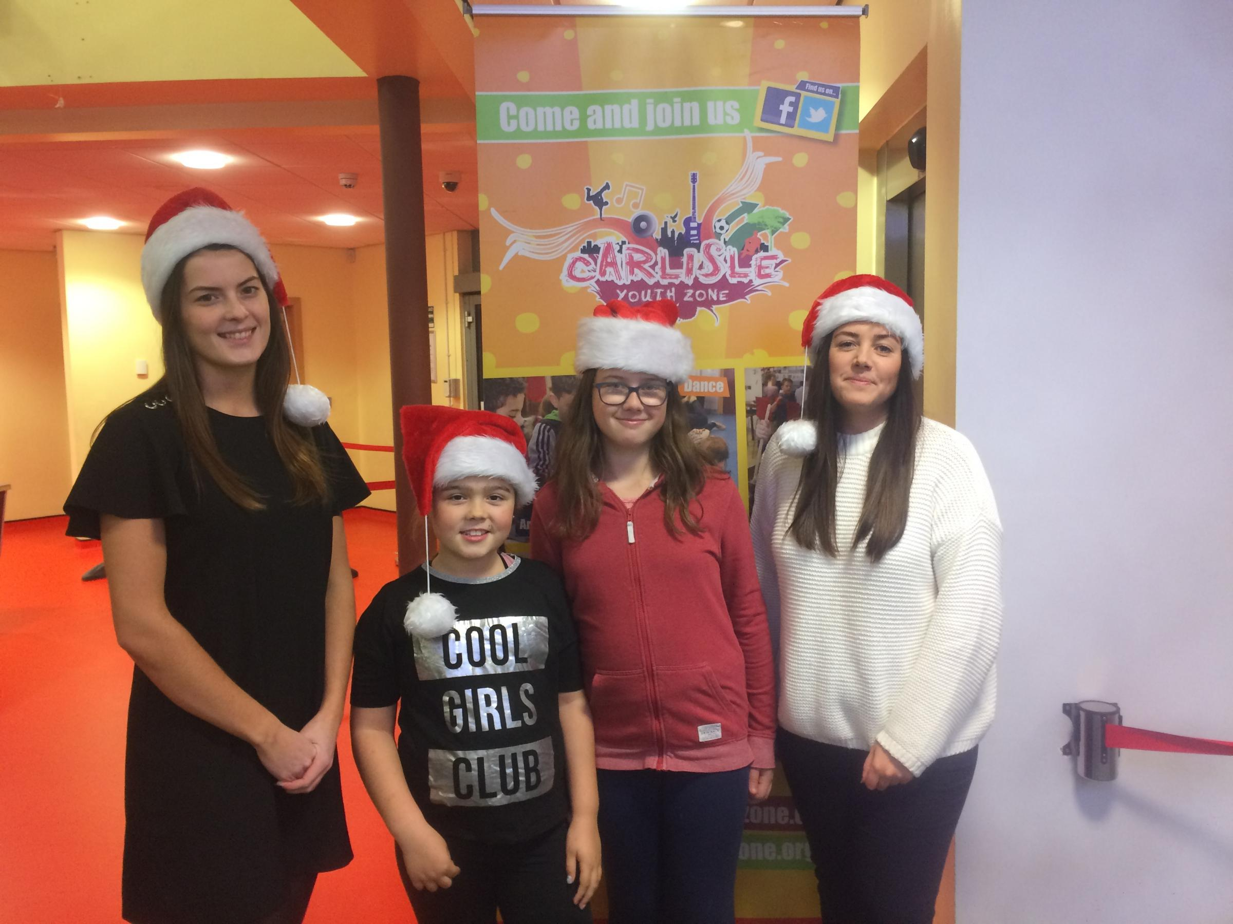 Becca Ferguson, of Dodd & Co, Amber Hodgson, nine, Caitlin Meek, 10 and Martha Winn, of Baines Wilson. The firms have donated cash to Carlisle Youth Zone instead of sending Christmas cards via the post