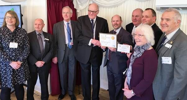 Lord Brougham centre making the presentation to James Woolgrove. From left South Cumbrian delegate Carol Stearne, Norman Stevenson, chairman of SGUK, Lord Cullen, who spoke about Piper Alpha and other South Cumbrian members Geoff Price, James Riddick, Val